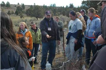 Dr. Carr discussing rangeland watershed management on a class field trip