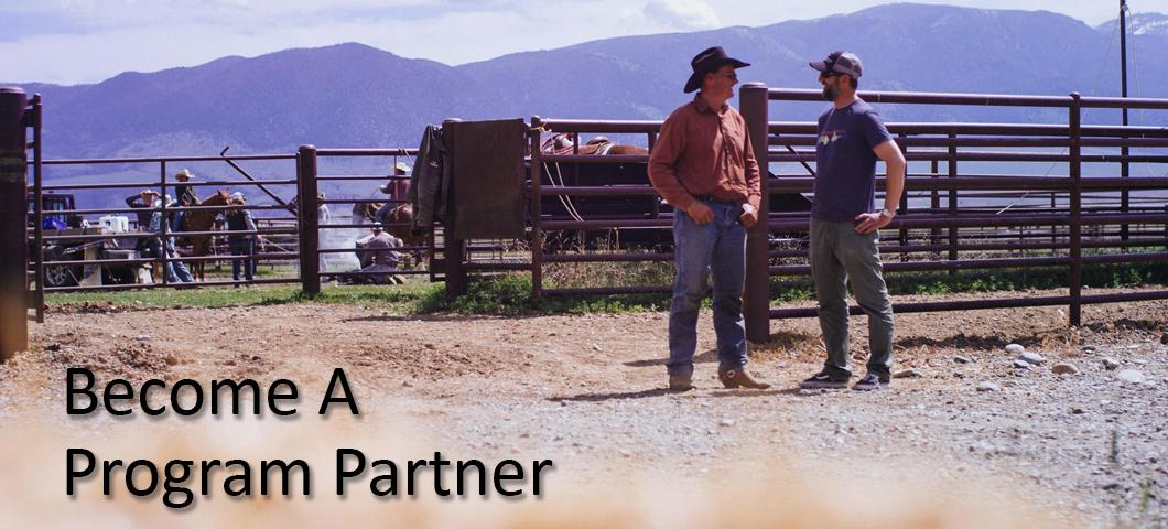 A rancher talking with another producer outside a paddock.